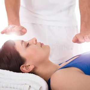 close-up-relaxed-young-woman-having-reiki-healing-treatment-woman-having-reiki-healing-treatment-147796489